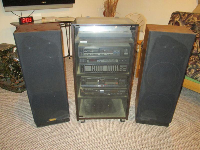 Item # 18    Pioneer Stereo System In A Wood U0026 Glass Cabinet W/ Two Eckman  Floor Speakers.