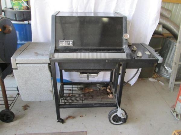 item 11 grill and smoker incl weber silver series propane grill and new braunfels wood or charcoal smoker