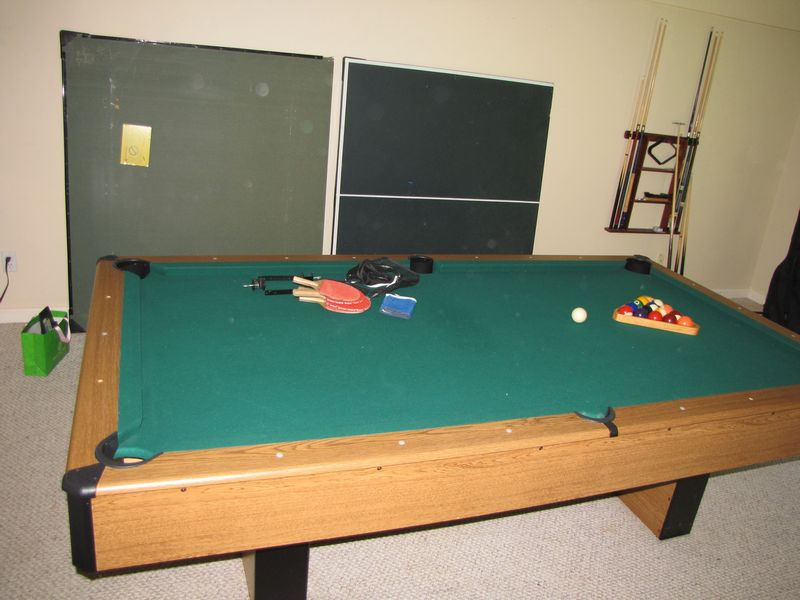 Item # 8    Modern Harvard Brand Pool Table With Ping Pong Table Top, Wall  Rack, Cues, Balls. Located Near Walk Out Door For Removal Via Back Yard.