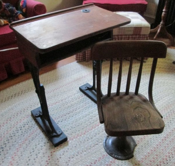 Item # 4 -- Two antique wood & iron student desks. One has authentic  inkwell and separate swivel chair by American Seating Co. 13