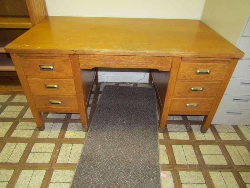 Item # 31 -- Office furniture including vintage oak mission style seven  drawer desk 30
