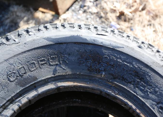 Item # 25 -- 11 tires including Tow Master 7-14.5LT, Cooper 7.00-15LT, Trailer Express 8-14.5lt on a rim, Goodyear 7-14 5, etc. Absolute Auctions \u0026 Realty