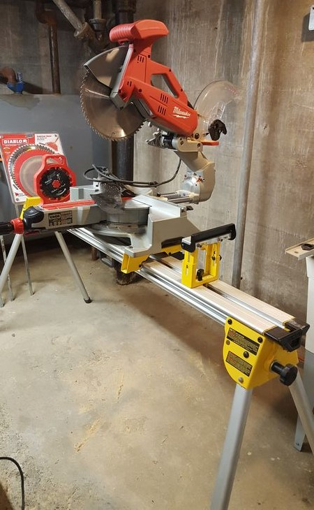 Absolute auctions realty item 5 milwaukee 12 sliding compound miter saw with dewalt stand 3 blades sanding disc dado kit located in basement greentooth Choice Image