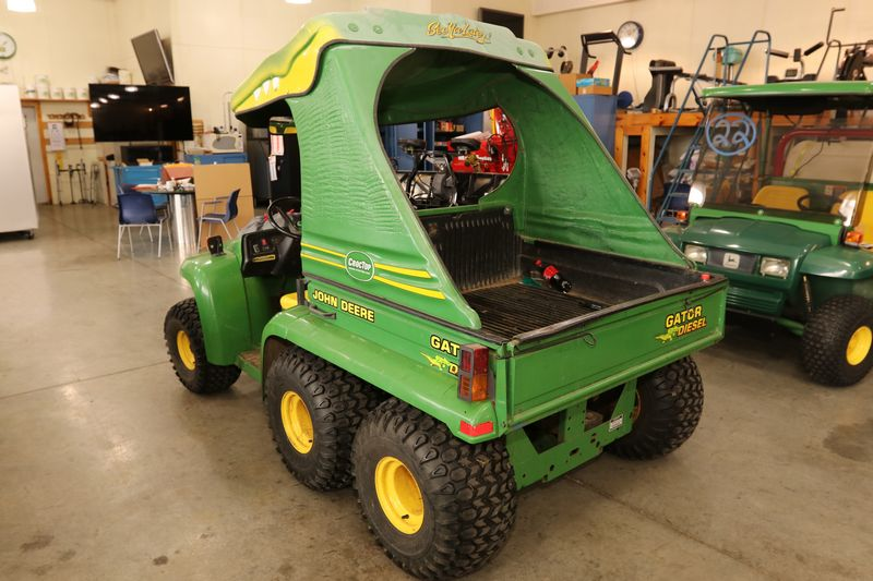Item # 24 -- 2000 John Deere 6x4 diesel gator with gator croc top canopy. Hours reading 1772. Serial number W006X4D013375. In running condition. & Absolute Auctions u0026 Realty