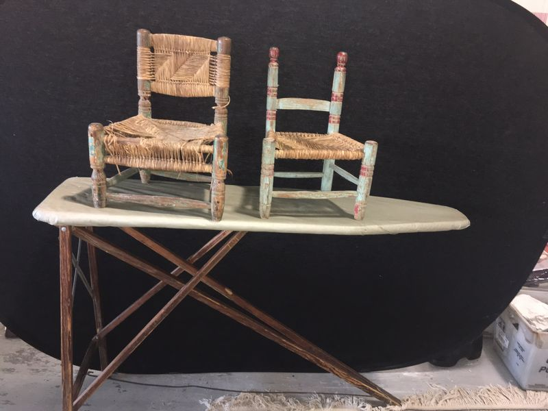 Item # 114 -- Antique wood ironing board and doll chairs. Ironing board  measures 47