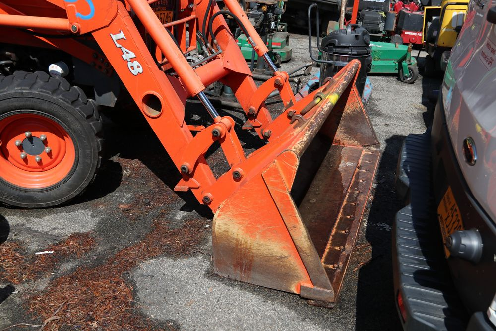 How to remove backhoe from kubota l48